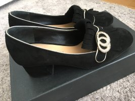 The seller Chaussure décontractée noir-doré cuir