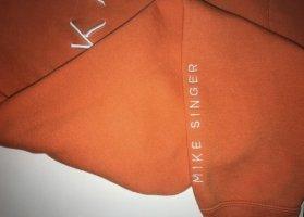 Maglione con cappuccio arancione-bianco