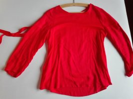 Farbfrohe Bluse in Korall
