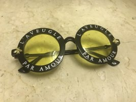 keine Gafas de sol redondas negro-amarillo