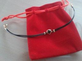 Bracelet en cuir noir-doré cuir