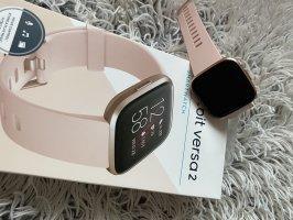fitbit Reloj digital color rosa dorado