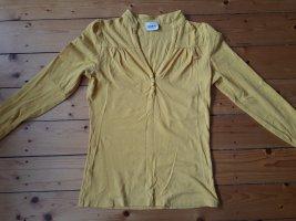 Gelbes Langarm-Shirt mit Knopf-Detail