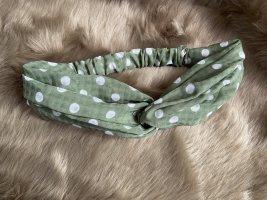 Copricapo bianco-verde bosco