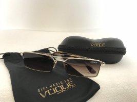 Vogue Lunettes de soleil angulaires doré métal