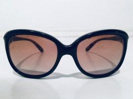Glamouröse Sonnenbrille von Oakley in Braun