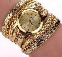Zegarek ze skórzanym paskiem złoto