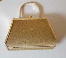 Goldene kleine Handtasche