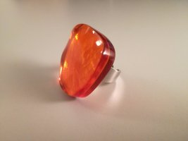 Bague incrustée de pierres orange-argenté