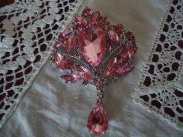 Broche rosa neón