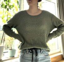 grüner strick-pullover