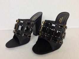 Gucci Tacones altos negro-color oro