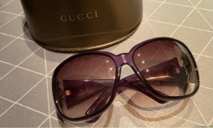 Gucci Ovale zonnebril bruin-paars