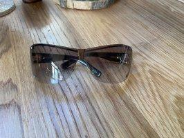 Gucci Occhiale da sole ovale nero-argento