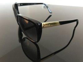 Gucci Lunettes de soleil angulaires noir matériel synthétique