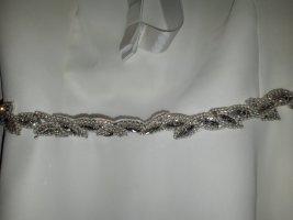 Cinturón pélvico blanco-color plata