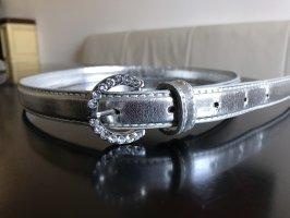Cinturón pélvico color plata