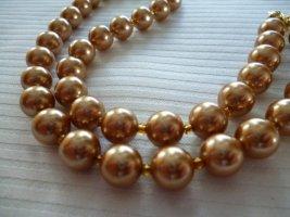 Collier de perles orange fluo