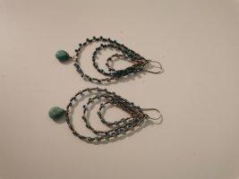 Boucle d'oreille incrustée de pierres argenté-turquoise