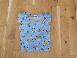 hellblaues geblümtes T-Shirt von Monki