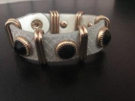 Hellgraues Leder-Armband mit goldenen Details