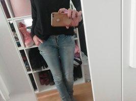 Jeans mit Glitzerpigmenten