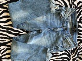 Jeansowe spodnie dzwony błękitny