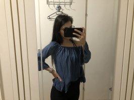 Haut avec une épaule dénudée bleu foncé-bleu