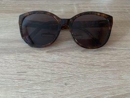 Kaum getragene Sonnenbrille