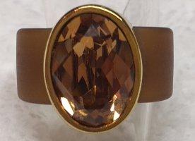 Pierścionek z ozdobnym kamieniem złoto-brązowy