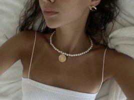 Collier de perles blanc-doré