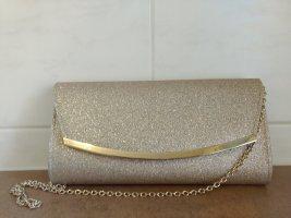 Kleine goldene Handtasche