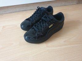 Puma Sneakers met veters zwart-goud