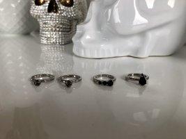 Konvolut aus silbernen Ringen von H&M - neu