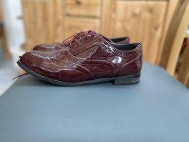Zapatos formales sin cordones burdeos