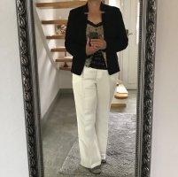 More & More Spodnie Marlena w kolorze białej wełny Len
