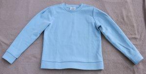 Suéter azul celeste