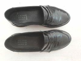 An other Babouche noir cuir
