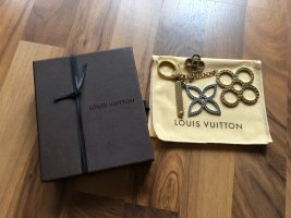 Louis Vuitton Llavero color plata-color oro