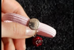 Marc Jacobs Armband / Haargummi in rosa mit roter Strasskugel
