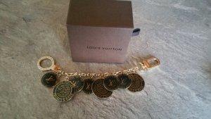 Louis Vuitton Medallion black-gold-colored