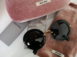 Miu Miu Gafas de sol redondas negro-naranja dorado