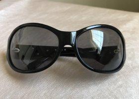 Miu Miu Occhiale da sole ovale nero-argento