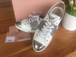 Miu Miu Studded Patent Metallic Toe Sneakers White