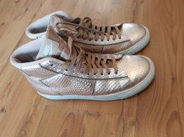 Nike Basket à lacet bronze-doré