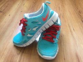 Nike Free Schuhe, hellblau, rot, weiß, Gr. 36
