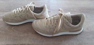 Nike Sneaker beige-gold Größe 39