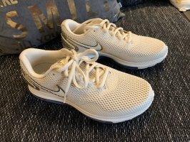 Nike Sneakers met hak goud-wit