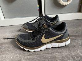 Nike Turnschuhe sneaker Joggingschuhe schwarz Gold free run 5.0