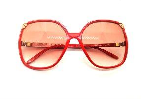Nina ricci Gafas de sol ovaladas color oro-rojo